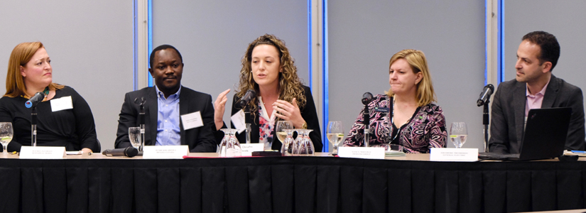photo of people participating in a panel discussion